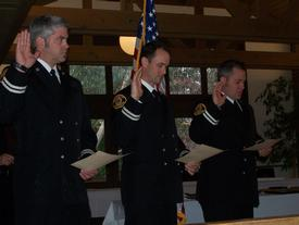 (L to R) Captain Munger, Captain Smith, and Captain Huffman being sworn in.
