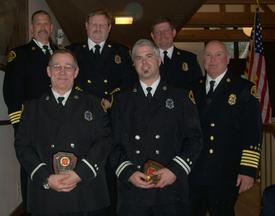 (First Row - L to R) Lieutenant Krimmert and Captain Munger receiving the Campbell Award (Firefighter of the Year) with (Second Row - L to R) Assistant Chief Brown, Assistant Chief Larsen, Assistant Chief Kranjcevich, and Chief Lipe