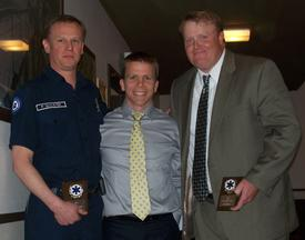 FF/EMT Paul Schuster (L) and FF/Paramedic Mark Brownell (R) receiving the EMS Award from Dr. Sam Warren.