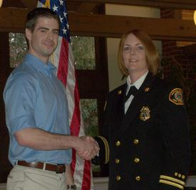 FF/EMT Cory Wallace receiving the High Driller Award from Battalion Chief Cari Coll
