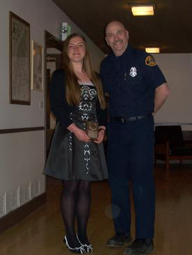 Lizzy Corliss receiving the Outstand Explorer Award from FF/EMT John Hemmer.