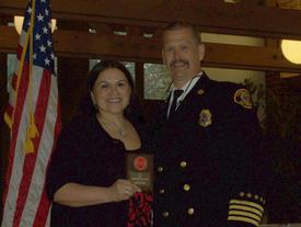EMT Yolanda Rugg receiving the Top Responder Award from Assistant Chief Brown