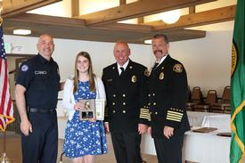 (left to right:) Explorer Advisor John Hemmer, Ellen Chappelka, Chief Lipe and Assistant Chief Brown, April 6, 2014.