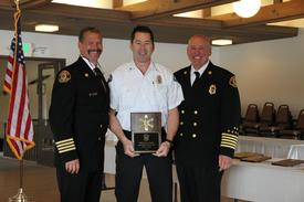 Left to right: Assistant Chief George Brown, Paramedic/Firefighter Myron Hauge, Fire Chief Hank Lipe.