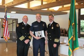 Chief Hank Lipe, John Hemmer and Assistant Chief George Brown.