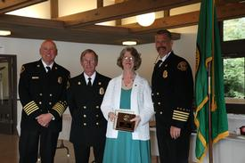 Left to right:  Fire Chief Hank Lipe, Firefighter Mike Kirk, Susan Wolf - District Secretary, Assistant Chief George Brown.