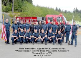 Volunteer Firefighter/EMT Justin Nelson appears with his graduating class second from the right, back row.